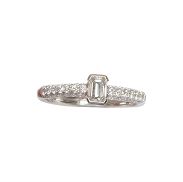 Vintage solitaire emerald cut diamond and white gold ring