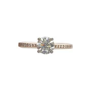 Vintage solitaire diamond and rose gold ring