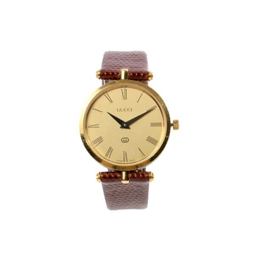 Gucci Logo round face watch with Lizard strap