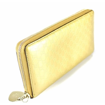 Picture of Gucci Gold Leather Monogram Wallet